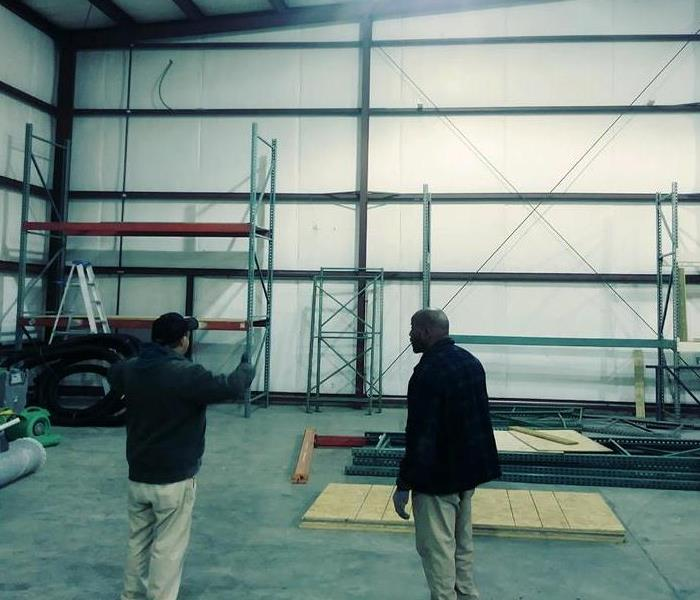 Installing shelving in new warehouse