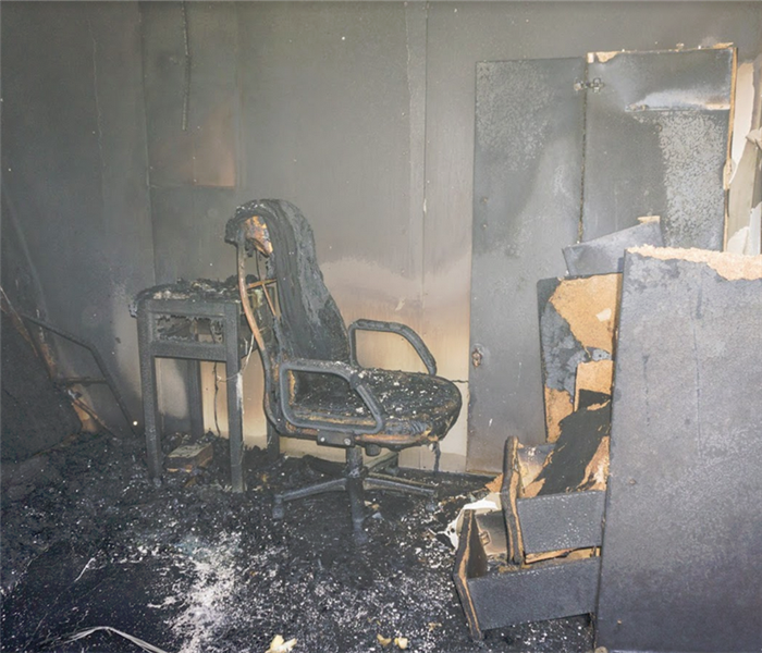burned office chair and desk in an office building