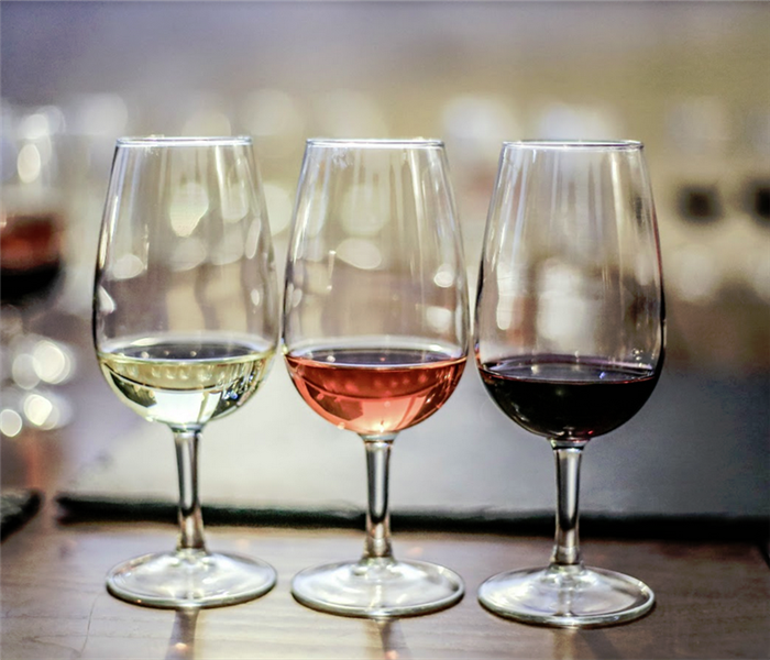 different glasses of wines on a table
